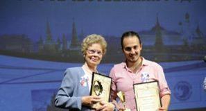 Фотографът Христо Русев и Раиса Дидарова с награди от Събора на руските сънародници, който се проведе в Плевен